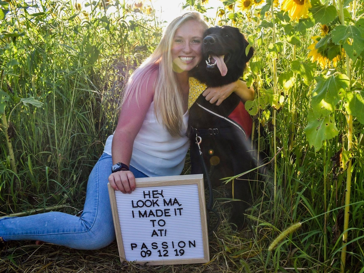 Morgan King '17 and her foster dog, Passion.  Morgan participates in 4 Paws for Ability's service dog foster college program through the University of Cincinnati.