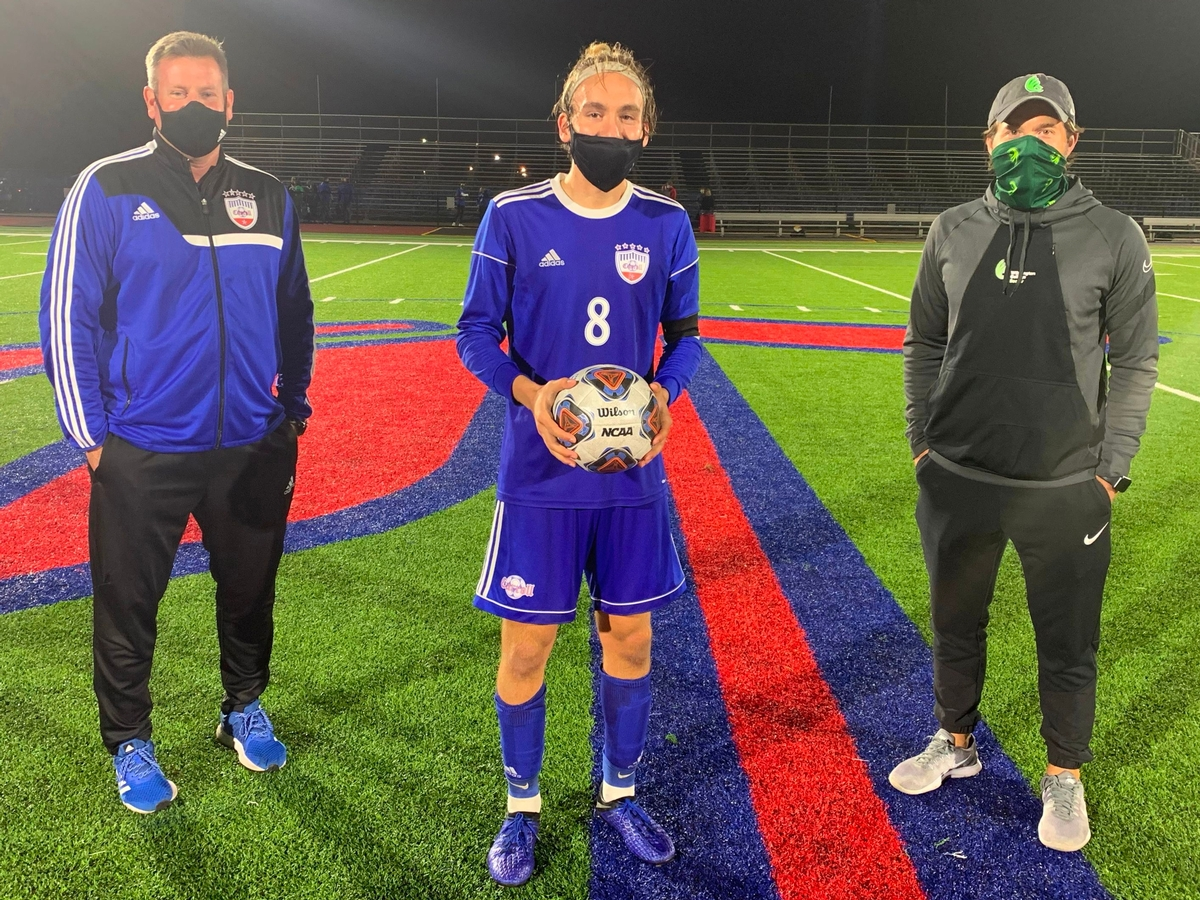 Conner Osterholt '21 broke the single season goal scoring record for Carroll Boys' Soccer with previous record holder Alex Van Der Sluijs in attendance.