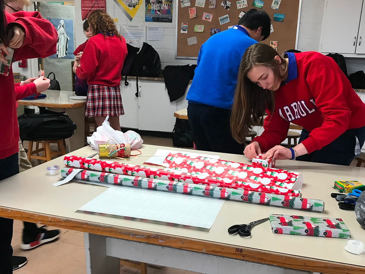 National Art Honor Society Students prepare and wrap Christmas gifts