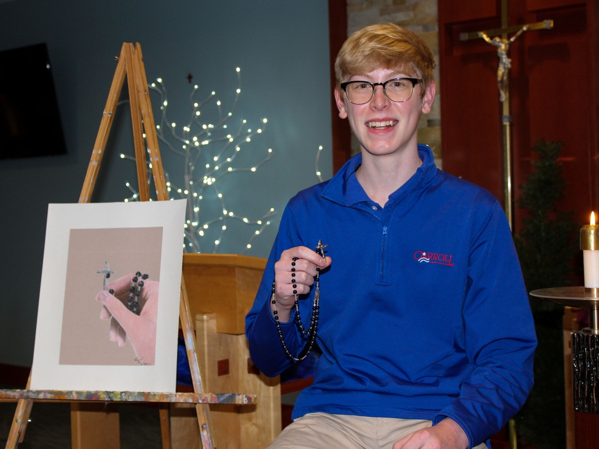 Carroll High School student Sam Wittmann '22 holds the rosary he received as a First Communion gift