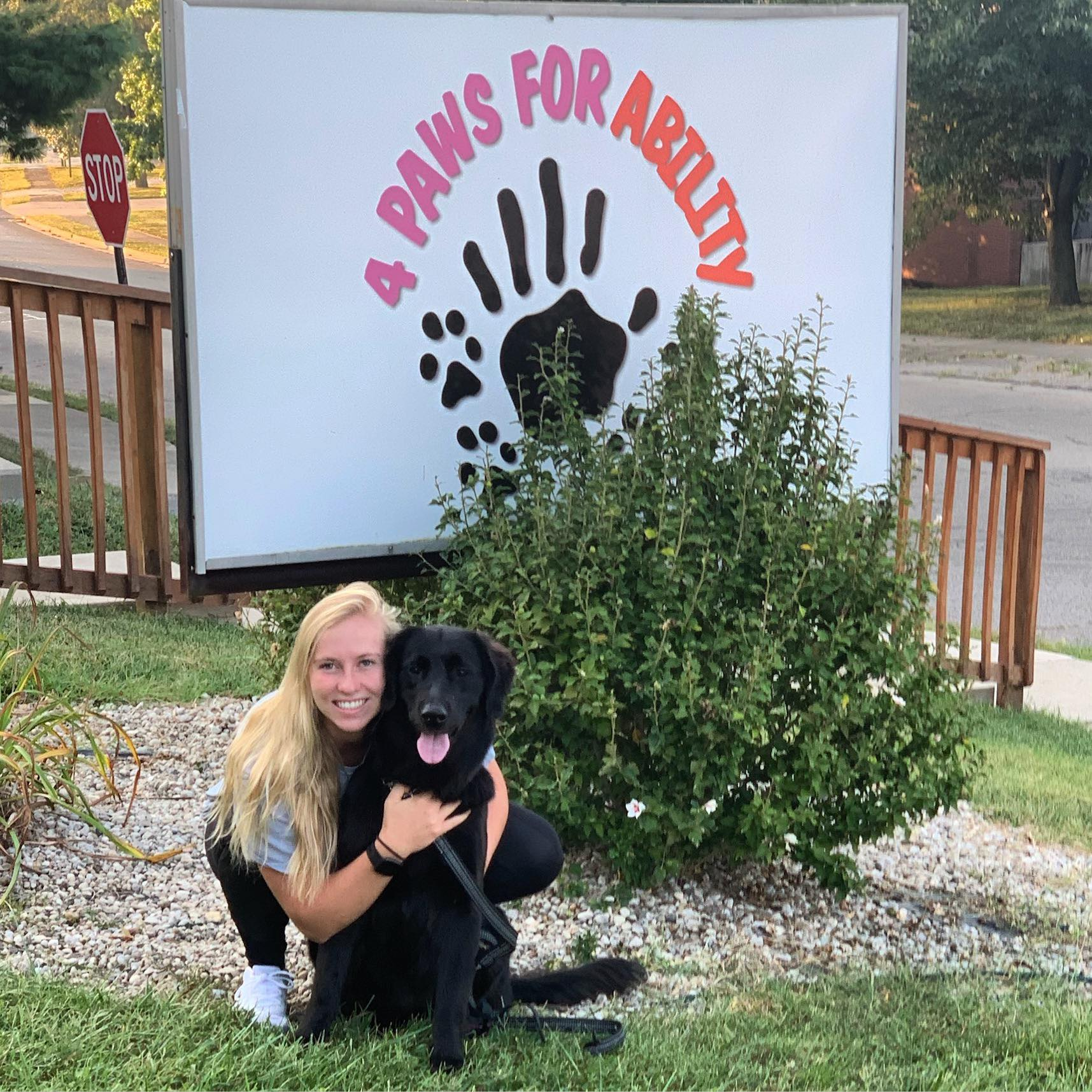 Morgan King '17 and a foster dog from 4 Paws for Ability.